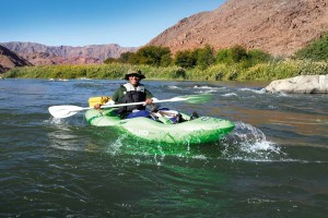 At the helm: Desert Kayak's river guides expertly guide the way. Photo credit Shaen Aedy.