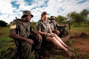 Sergeant Daniel Chavalala, Sandra and Daniel Nwayila record the latest sighting – buffalo – in the cybertracker, a handy device that electronically files reports on poaching incidents, fire and other events.
